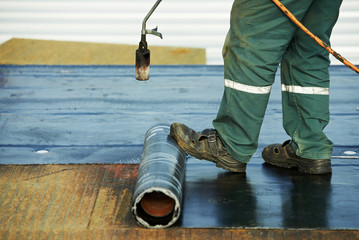Flat roof covering repair works with roofing felt
