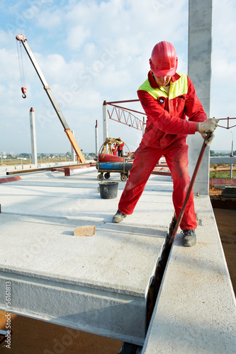 builder worker installing concrete slab