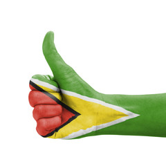 Hand with thumb up, Guyana flag painted