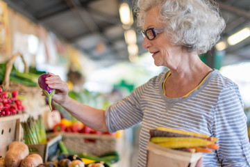 senior woman shopping at the farmer's market