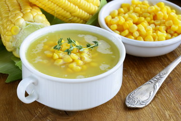 soup of fresh yellow corn served on a wooden table