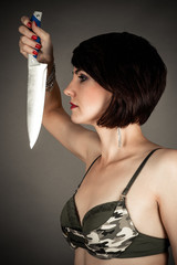 profile of beautiful woman with a knife in hand