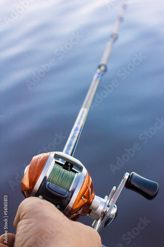 Angler use multiplier fishing reel