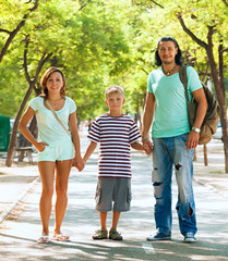 Happy family of three with teenager