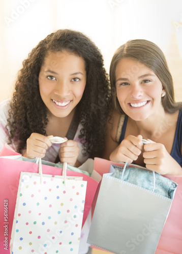 Happy Teenage Girls Carrying Shopping Bags