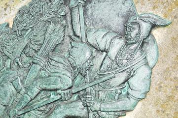 Basrelief depicting Robin Hood at Nottingham Castle, England.