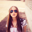 Young stylish brunette in sun glasses