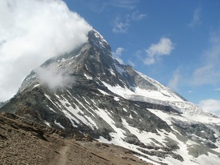 Pathway to Hörnli Hut with Matterhorn 4478 m in clouds