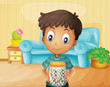 A boy inside the house with a jar of candies