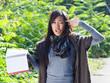 Asian girl holds her hand like a gun near her head
