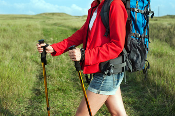 Close up of hiking young woman with backpack