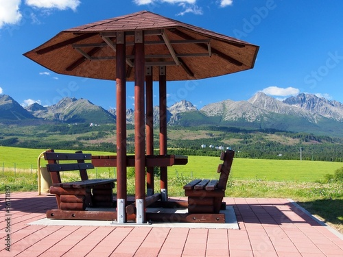 Benches under shelter and High Tatras