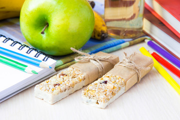 Healthy school lunch for kids with stick berry muesli and apple