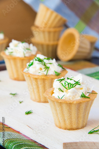 Tasty appetizer, tartlet with cheese, dill and garlic
