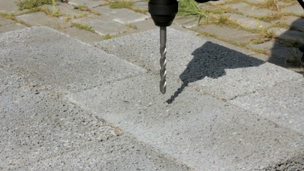 Drilling hole into concrete. Outdoor.