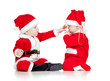 two funny small kids in Santa Claus clothes isolated on white ba
