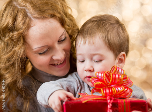 mother and son with gift over festival background