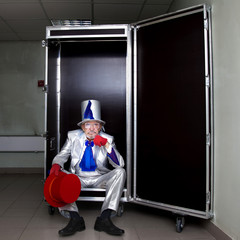 Magician sitting in a box