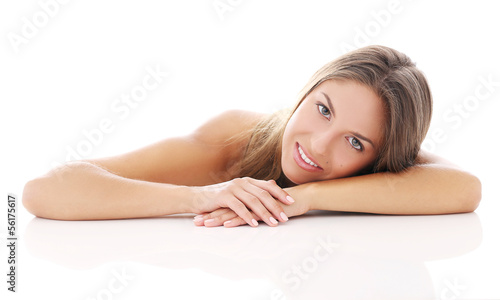 Beautiful girl lying on her arm