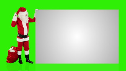 Santa Claus shaking bell presenting a white sheet, Green Screen