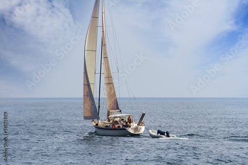 Sailing boat in open waters