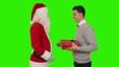 Businessman receiving a present from Santa Claus, Green Screen