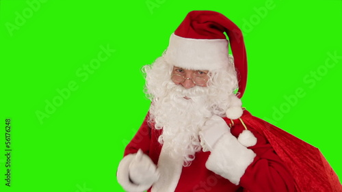 Santa Claus carrying his bag, sends a kiss, Green Scree
