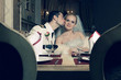 Portrait of kissing bride and groom sitting in restaurant