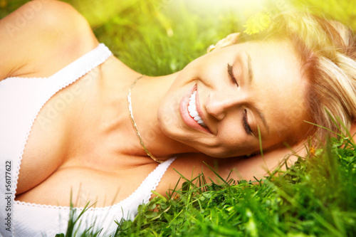 woman relaxing on grass.
