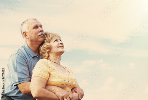 Old people over sky background
