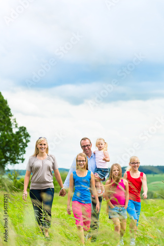Happy Family walking in the meadow
