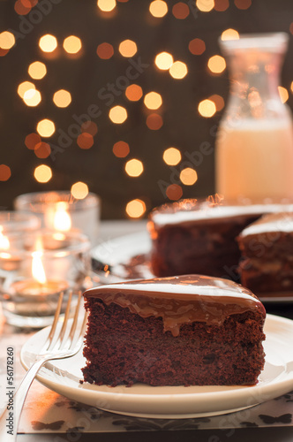 Chocolate cake with blurry christmas lights.