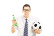 Scared male in shirt holding a beer bottle and football