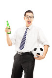 Smiling male in shirt holding a beer bottle and football