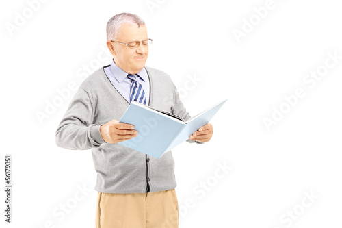 Smiling middle aged gentleman reading a book