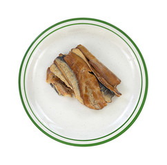 Smoked herring fillets on a green striped plate