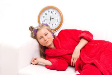 sleepy woman with a clock