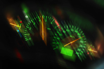 Sports car dashboard at night