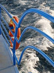 red lifebuoy blue sea