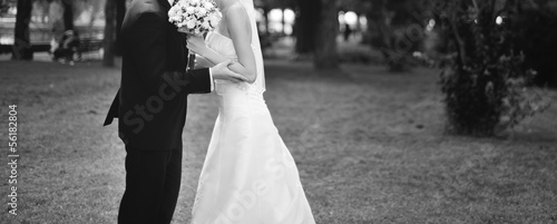 fashionable groom and bride embracing