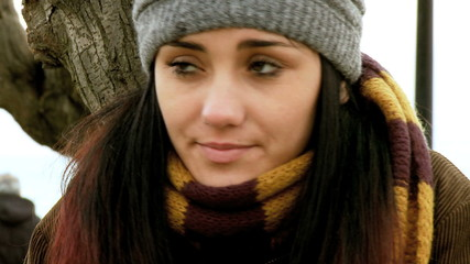 Young caucasian woman freezing in the winter with hat and scarf