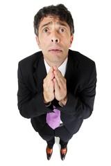 Desperate businessman praying