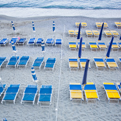 beach umbrellas with chairs