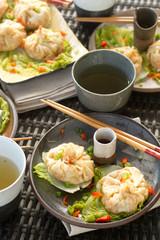 steamed dumplings plated vertical