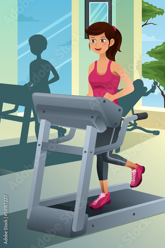 Woman running on a treadmill in a gym