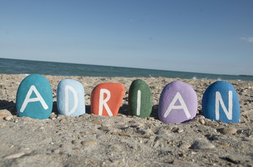 Adrian, male name on colourful stones