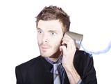 Young businessman listening to telephone can