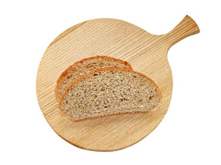 Pieces of bread on the chopping board (isolate)