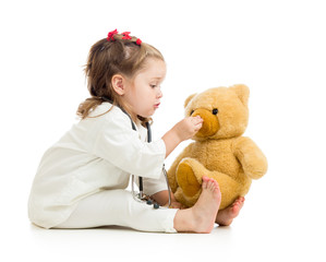 child girl playing doctor with toy