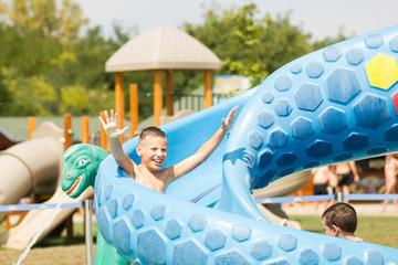 Happy boy on water slide